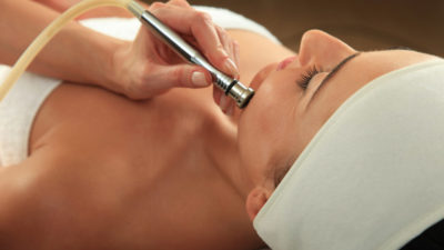 Woman receiving massage - microdermabrasion